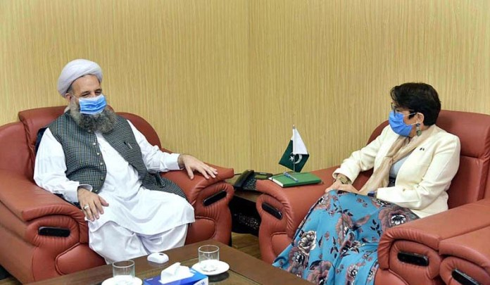 ISLAMABAD: September 01 - Federal Minister for Religious Affairs & Inter-Faith Harmony, Pir Noor-Ul-Haq Qadri in a meet with Androulla Kaminara, European Union Ambassador to Pakistan. APP