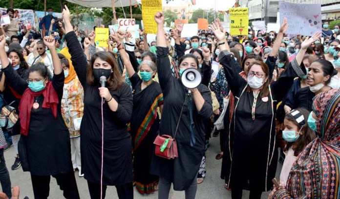 KARACHI: September 12 - Women activists belonging to different NGOs staging a protest demonstration against motorway incident and demand early arrest of culprits in front of Press Club. APP Photo by Saeed Qureshi