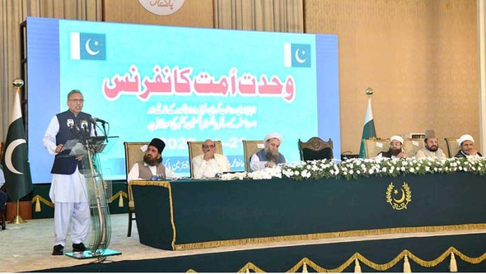 ISLAMABAD: September 21 - President Dr. Arif Alvi addressing 'Wahdat-e- Ummat Conference' at Aiwan-e-Sadr. APP