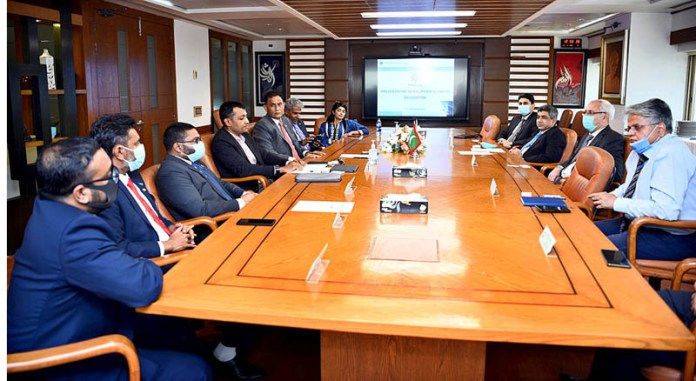 KARACHI: September 22 - Chairman Pakistan National Shipping Corporation Shakeel Ahmed Magnejos in a meeting with five-member business delegation from Maldivian. APP Photo by Abbas Mehdi