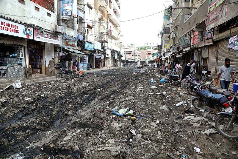 KARACHI: September 01 – A view of stagnant rainwater accumulated became massive garbage in old city area. APP Photo by Saeed Qureshi