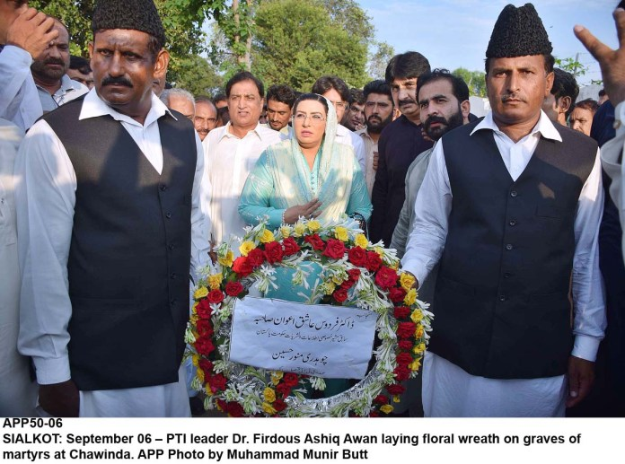 SIALKOT: September 06 – PTI leader Dr. Firdous Ashiq Awan laying floral wreath on graves of martyrs at Chawinda. APP Photo by Muhammad Munir Butt