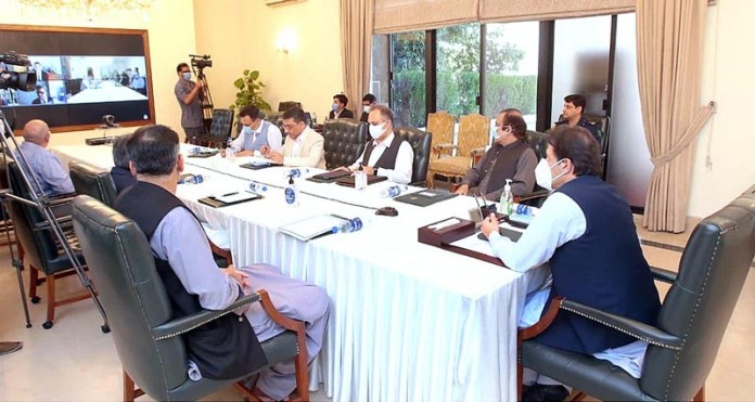 ISLAMABAD: September 18 - Prime Minister Imran Khan chairing a meeting regarding reforms in the power sector. APP