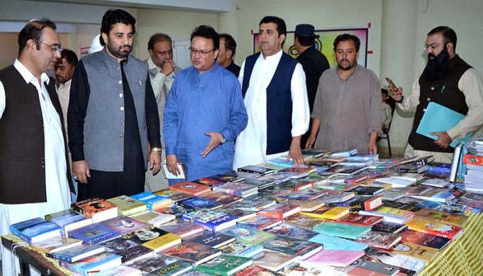 QUETTA: September 23 - Deputy Speaker National Assembly Qasim Khan Suri being briefed about the displayed books during a seminar on Increasing Seats of Provincial and National Assemblies organized by Press Club on the occasion of Golden Jubilee of QPC. APP photo by Mohsin Naseer