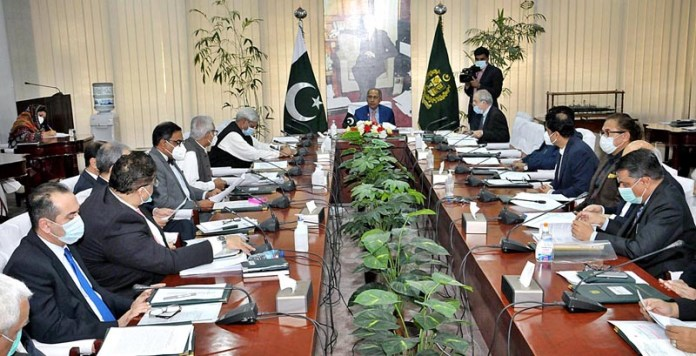 ISLAMABAD: October 26 – Adviser to PM on Finance Abdul Hafeez Shaikh chairing the ECC meeting. APP photo by Saeed-ul-Mulk