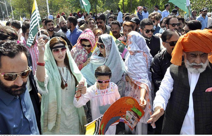 ISLAMABAD: October 03 - Chairperson Peace and Culture Organization and Hurriyat leader Mushaal Yasin Malik wife of jailed Kashmiri Hurriyat leader Mohammad Yasin Malik leading a protest demonstration from China Chowk to National Press Club against human rights violations in Indian Occupied Jammu and Kashmir and release of political prisoners. APP photo by Saleem Rana