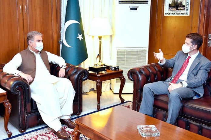 ISLAMABAD: October 13 - British High Commissioner Dr. Christian Turner called on Foreign Minister Makhdoom Shah Mahmood Qureshi at Ministry of Foreign Affairs. APP
