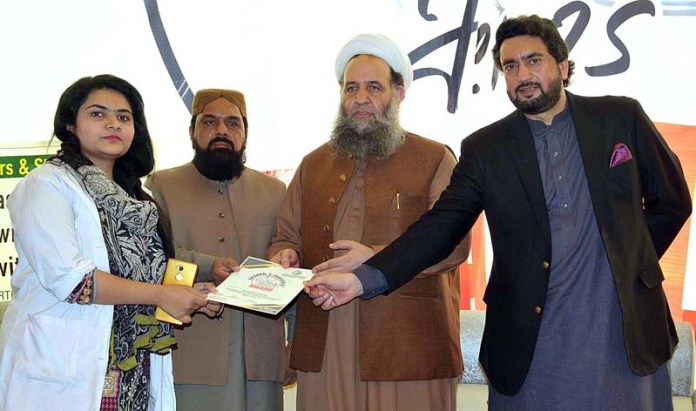 ISLAMABAD: October 31 - Chairman Kashmir Committee Shehryar Afridi and Federal Minister for Religious Affairs and Inter-Faith Harmony Noorul Haq Qadri distributing certificates and shields among the participants during a seminar arranged by Patriotic Association of Private Schools. APP photo by Saeed-ul-Mulk