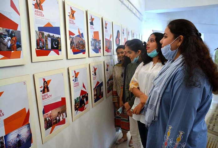 LAHORE: October 07 – Visitors viewing the displayed stuff during an exhibition at Alhamra Arts Council. APP photo by Ashraf Ch