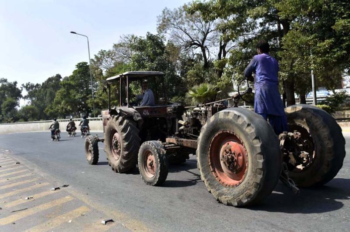 FAISALABAD: October 12 - An out-of-order tractor tow-chained to shift the workshop for removing faults. APP photo by Muhammad Waseem