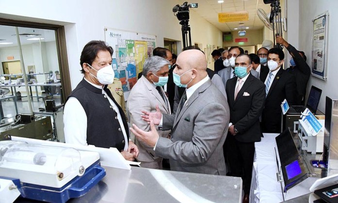 ISLAMABAD: October 16 – Prime Minister Imran Khan visiting various sections of N-Ovative Health Technologies Facility at National University of Science and Technology (NUST). APP