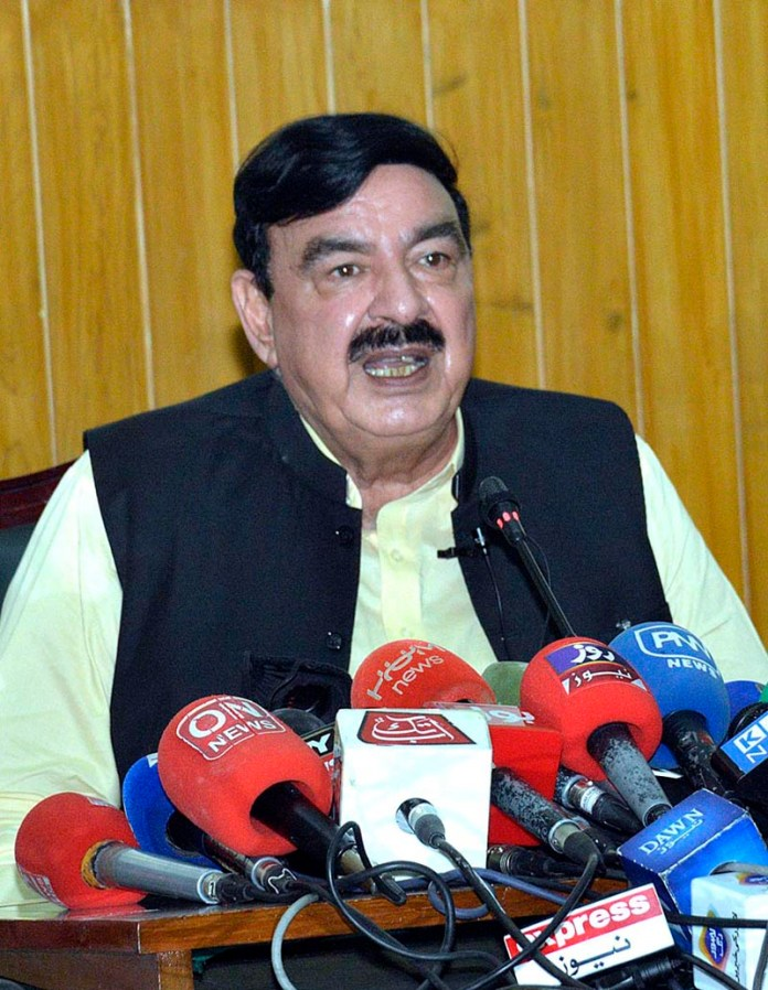 LAHORE: October 24 - Federal Minister for Railways Sheikh Rashid Ahmad talking to media. APP