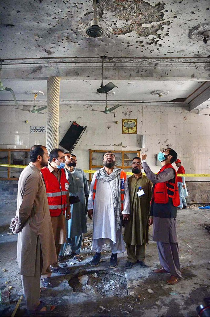 PESHAWAR: October 27 – Rescue officials collecting evidence from the spot after bomb blast in the Masjid at Dir Colony at least 7 persons died and 70 injured in this incident. APP Photo by Shaheryar Anjum