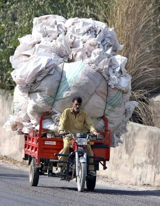 APP15-16 RAWALPINDI: October 16 – An overloaded motorcycle loader on the way on Expressway may cause any mishap and needs the attention of the concerned authorities. APP photo by Abid Zia
