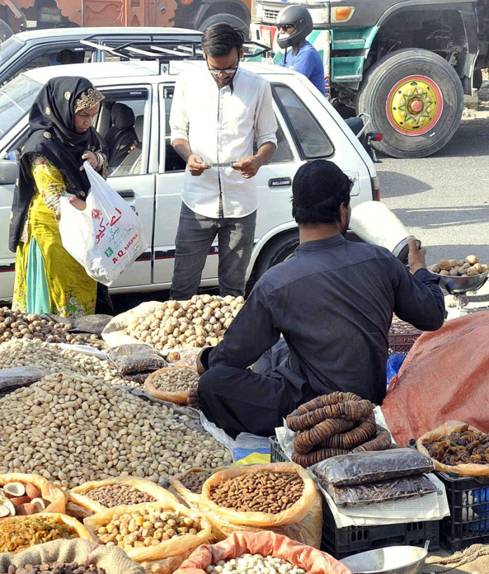 ISLAMABAD: October 10 – A vendor displaying different kind of dry fruits to attract the customers at his roadside setup on the sidelines of IJP Road. APP photo by Saleem Rana
