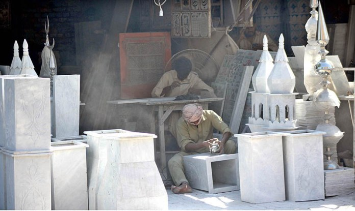 MULTAN: October 10 - Worker busy in giving shape to marble at his workplace. APP photo by Tanveer Bukhari