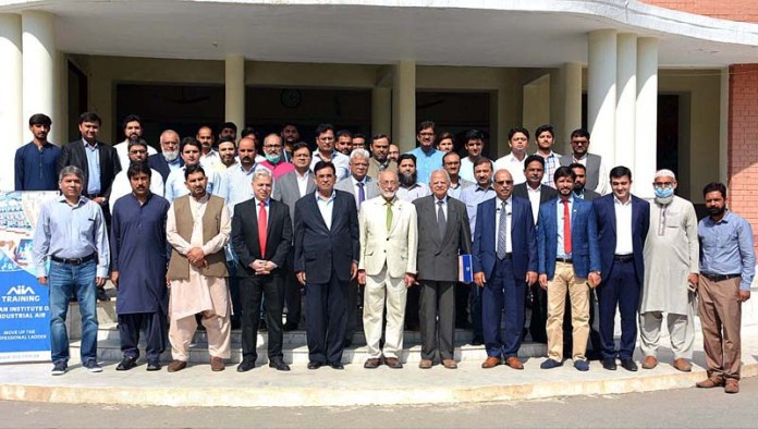 FAISALABAD: October 16 - Group photo of Rector National Textile University Faisalabad (NTUF) Dr Tanveer Hussain and Chairman Chenab Limited Mian Latif with other participants during inauguration ceremony of Compressed Air Centre of Excellence at University. APP photo by Tasawar Abbas