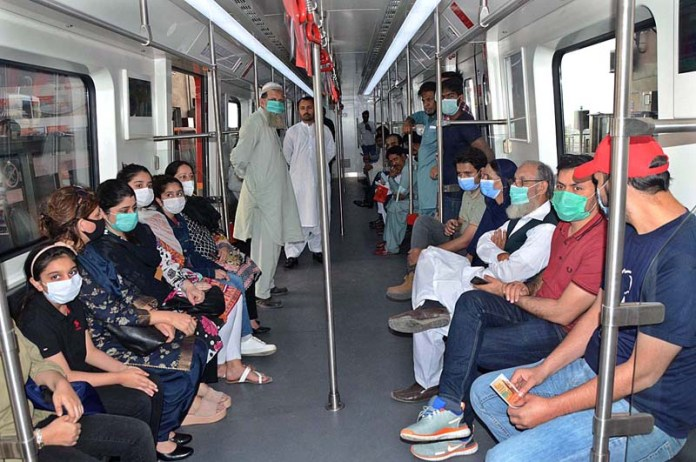 LAHORE: October 25 – Passengers traveling on the Orange Line Train after inauguration. APP photo by Ashraf Ch