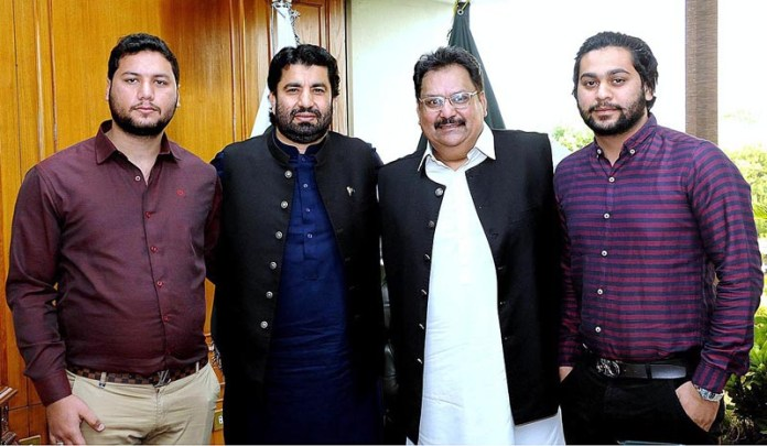ISLAMABAD: October 02 - Deputy Speaker National Assembly Qasim khan Suri in a group photo with Members of Executive body of Pakistan Tehreek-e-Insaf Central Punjab in Parliament House. APP