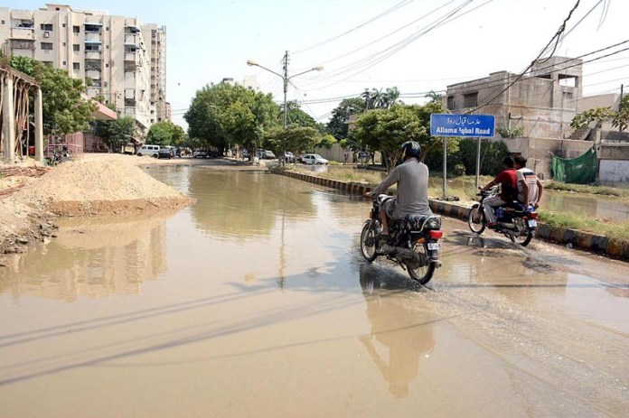 KARACHI: October 01 - Sewage water accumulated on Allama Iqbal Road shows the negligence of concerned authorities. APP photo by M Saeed Qureshi