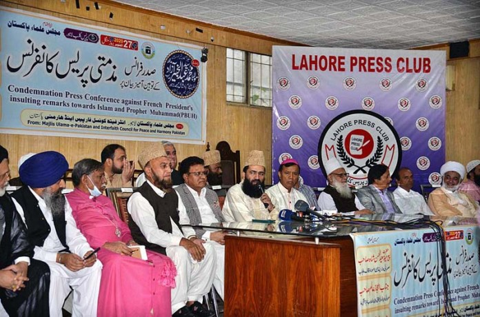 LAHORE: October 27 – Members of Majlis-e-Ulema Pakistan addressing a press conference to condemn French President's remarks. APP photo by Amir Khan