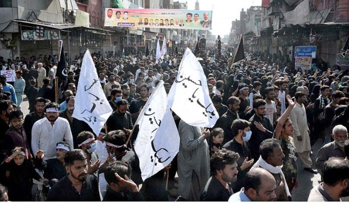 FAISALABAD: October 08 - A large number of mourners attending the Chehlum procession to commemorate the martyrdom of Hazrat Imam Hussain (AS) , grandson of Holy Prophet (SAWW) in Karbala. APP photo by Tasawar Abbas