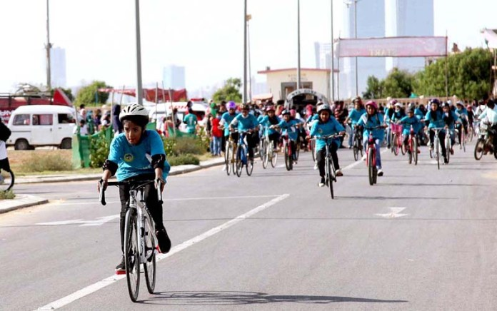 KARACHI: October 11 – A large number of girls participating in bicycle rally with the slogan of ( Aao Cycle Chalayen ) on International Day of the Girls 2020 organized by Lyari Girls Cafe Karachi at Sea view road in Provincial Capital. APP Photo by M Saeed Qureshi