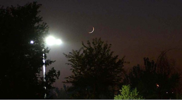 ISLAMABAD: October 18 – A view of Rabbi-ul-Awwal moon over the skies of the Federal Capital. APP photo by Irshad Sheikh