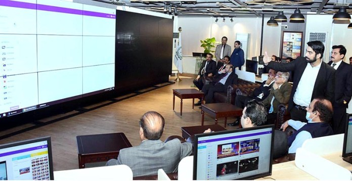 ISLAMABAD: October 14 - Senator Shibli Faraz, Federal Minister for Information and Broadcasting being briefed regarding the monitoring system of PEMRA. APP