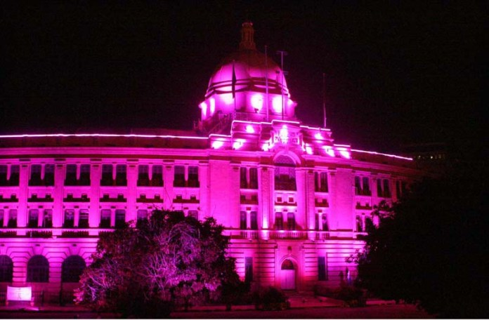 KARACHI: October 09 - A view of Pink Illumination of Karachi Port Trust (KPT) Building on the eve of Breast Cancer Awareness to mark Pink Ribbon Month. APP photo by Syed Abbas Mehdi
