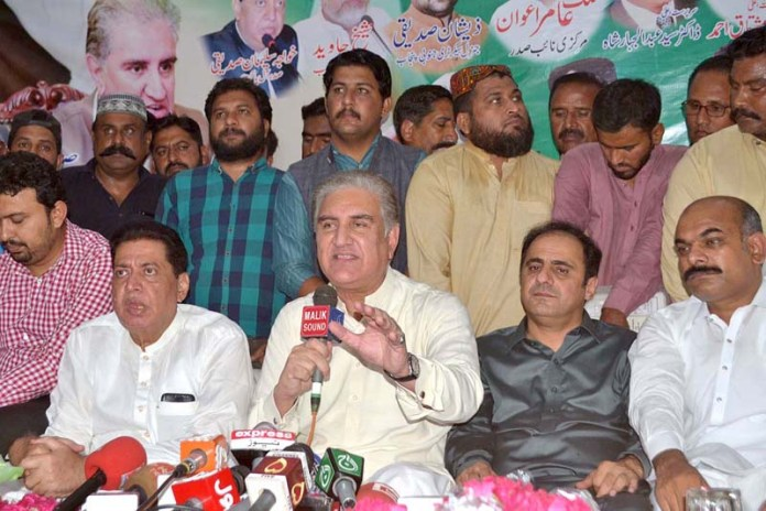 MULTAN: October 10 - Foreign Minister Makhdoom Shah Mahmood Hussain Qureshi talking to media during oath ceremony of newly elected body of members of Traders Old Shujabad Road. APP photo by Safdar Abbas