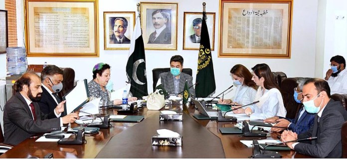 ISLAMABAD: October 15 - Federal Minister For Law And Justice, Barrister Dr. Muhammad Farogh Naseem chairs a meeting regarding Child Pornography And Abandoned Babies at the Law Ministry. APP