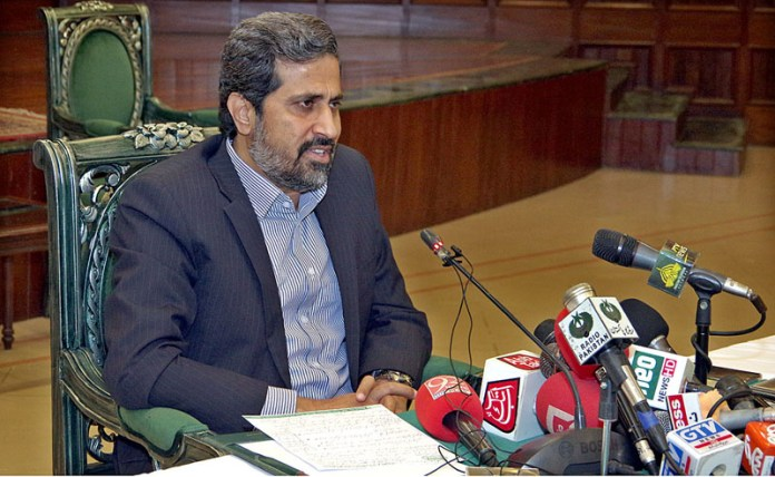 LAHORE: October 16 - Provincial Minister for Information Fayyaz-ul-Hassan Chohan addressing press conference. APP photo by Rana Imran