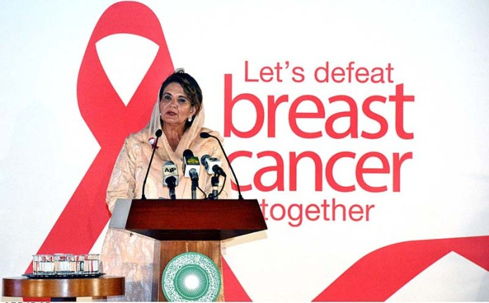 """KARACHI: October 25 - First Lady Mrs. Samina Arif Alvi addressing to the Breast Cancer Awareness Program """"Let's Defeat Breast Cancer Together"""" organized by AKUH at Aga Khan Sports Complex. APP photo M. Saeed Qureshi"""