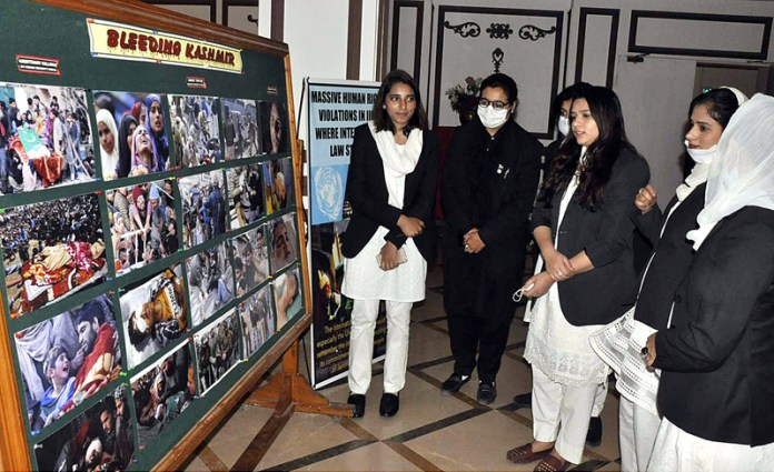 ISLAMABAD: October 23 - Visitors viewing the displayed pictures during one day Kashmir Conference on Kashmir's Prolonged Military Occupation Lessons from History and the Way Forward organized by the Legal Forum for Oppressed Voices of Kashmir (LFOVK). APP photo by Saleem Rana