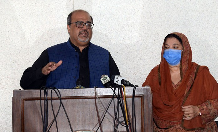 LAHORE: October 14 - Special Assistant to PM on Interior and Accountability Shahzad Akbar along with Punjab Health Minister Dr. Yasmin Rashid addressing a press conference. APP photo by Amir Khan