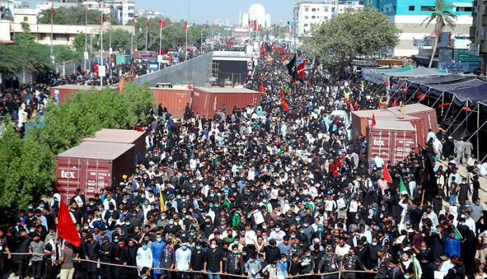 KARACHI: October 08 - Shiite Muslims attending religious procession to mark Chehlum of Imam Hussan at M A Jinnah road. APP Photo by M Saeed Qureshi