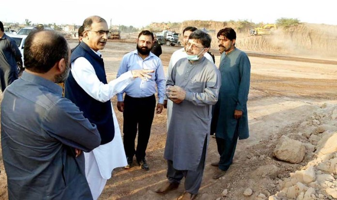 RAWALPINDI: October 16 - Director General FGE Housing Authority Waseem Hayat Bajwa is being briefed during progress review visit of Chaklala Heights Apartments. APP