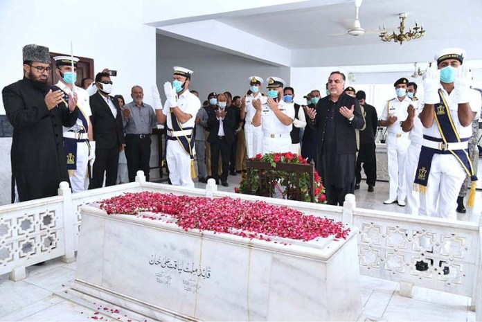 KARACHI: October 16 - Sindh Governor Imran Ismail offering Fateha at the grave of Shaheed Liaquat Ali Khan as 69th death anniversary of the great leader on Friday. APP