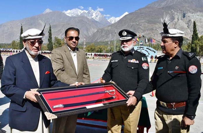 GILGIT: October 27 - IGP Gilgit-Baltistan presenting souvenir to Caretaker Chief Minister Gilgit-Baltistan DIG (R) Mir Afzal Khan awarding certificates during police passing out parade at Police Training Center. APP Photo by Ashraf Hussain Nasiri