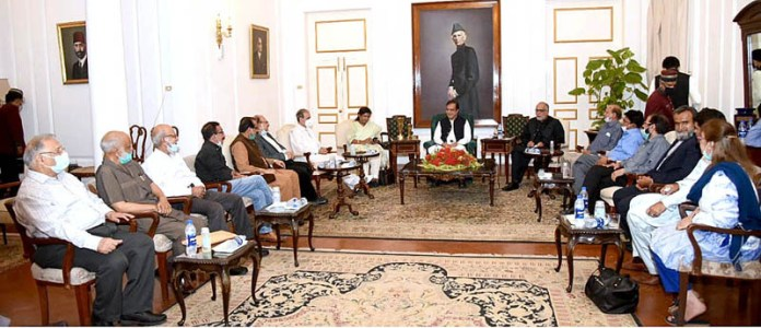 KARACHI: October 07 - Federal Minister for Information and Broadcasting in a meeting with the editors & columnist at Governor House. APP