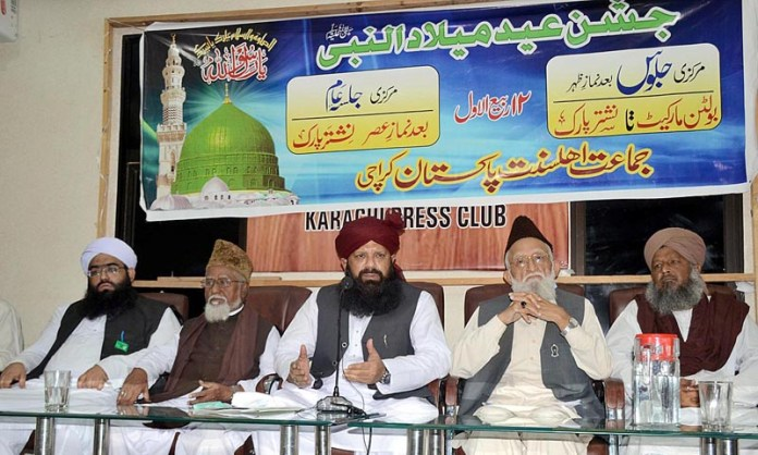 KARACHI: October 22 - Chief of Jamaat Ahle Sunnat Pakistan Allama Syed Shah Abdul Haq Qadri Qadri along with former Federal Minister Haji Muhammad Hanif Tayyab and others addressing Press Conference in connection with Eid-e-Milad-un-Nabi (SAWW) at Karachi Press Club. APP photo by Syed Abbas Mehdi
