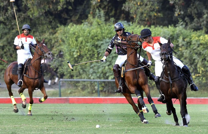 LAHORE: October 22 - FG Polo team and Olympia, FG Polo team trying to get hold on the ball during the Lulusar Polo in Pink 2020, first semifinal between FG Polo team and Olympia, FG Polo teams, FG Polo team routed Olympia by 13-5 qualify for the Lulusar Polo in Pink 2020 main final. APP photo by Rana Imran