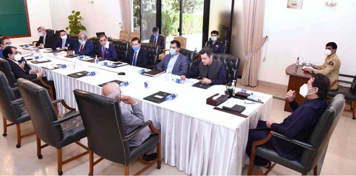 ISLAMABAD: October 15 - Prime Minister Imran Khan meeting with a delegation of Manufacturers. APP