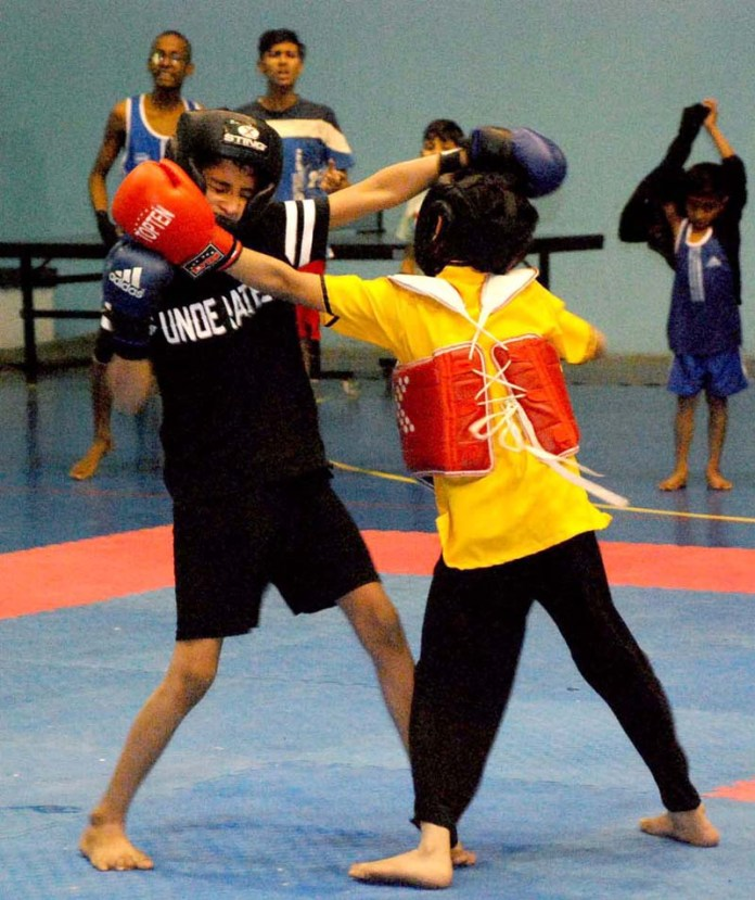Players in action during final of Wushu Kungfu Boys and Girls Tournament at Stadium