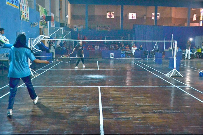 MULTAN: November 11 - Players in action during District Badminton Tournament at Sports Gymnasium. APP photo by Safdar Abbas