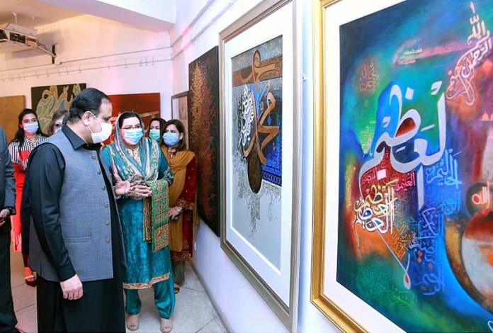 Chief Minister Punjab Sardar Usman Buzdar keenly viewing calligraphy art during an exhibition at Alhamra Arts Council