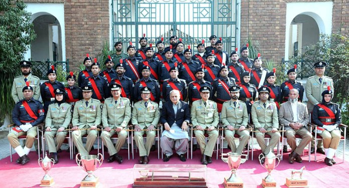 A group photo of Assistant Superintendents of Police with Federal Minister for Interior, Brig (Retd) Ijaz Ahmad Shah on occasion of their passing out parade