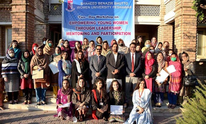 Secretary Social Welfare Department Manzoor Ahmad and VC SBBWU Prof. Dr. Razia Sultana in a group photo with participants during the closing ceremony of two-day workshop on