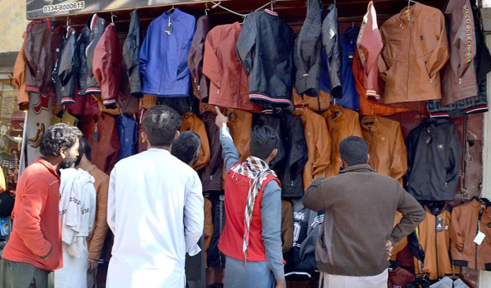 QUETTA: November 06 – People are busy for purchasing leather jackets in view of winter season at Liaqaut Bazaar. APP photo by Mohsin Naseer